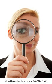 Big brother is watching you: business woman with magnifying glass to the eye over white background