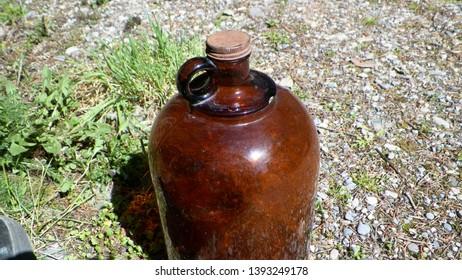 Big brown vintage moonshine jug