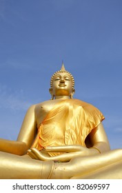 Big Buddha Image of the sky against a backdrop of Wat Thai in Thailand