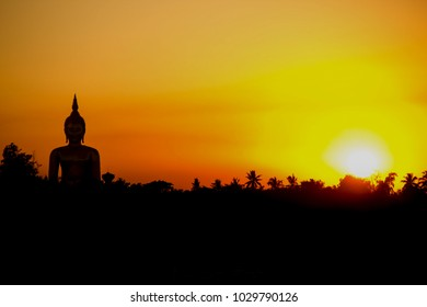 Big Buddha statue in the background is the sunset on the countryside of Thailand.Large Buddha image Silhouette