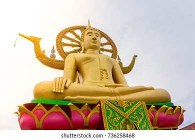 """Big Buddha statue in gold color at """"Big Buddha Temple"""" in Thailand."""