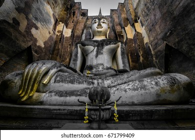 Big Buddha Statue sitting in the calling to Earth position or Earth touching Buddha in an ancient temple in Thailand. Buddhist inner peace background.