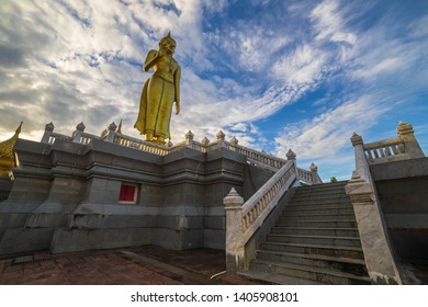 Big Buddha statue standing on blue sky background