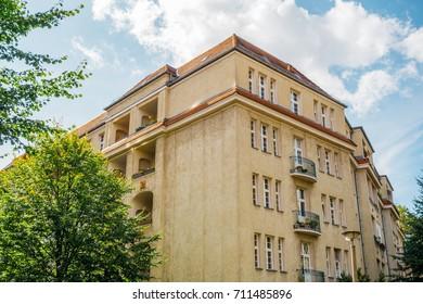 big building in berlin with orange facade