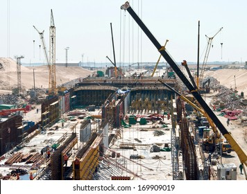 The big building. Cranes at the construction of the tunnel
