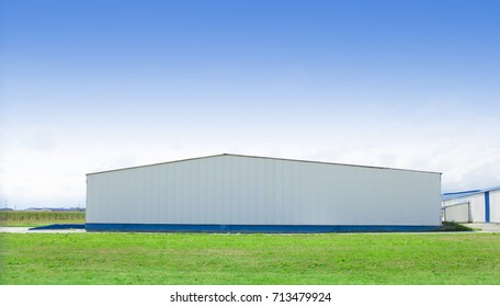 big building in fresh landscape with clear blue sky