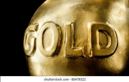 Big bullion of gold. Isolated on black