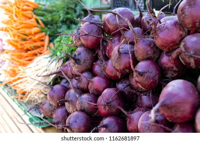 A big bunch of red beetroot at market.