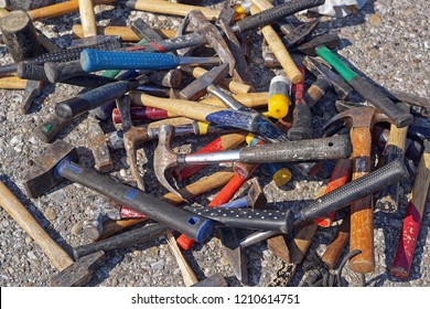 Big bunch of various shape and sizes of used hammers tools
