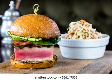 Big Burger with grilled tuna and coleslaw is on the Board.