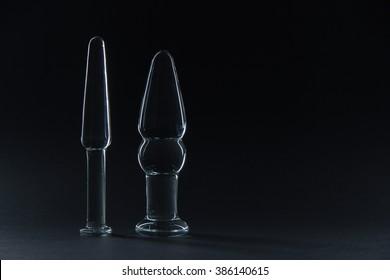 Big Butt plug transparent glass on a black background