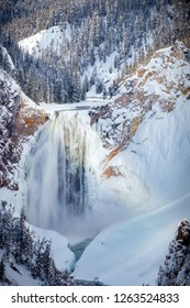 Big Canyon waterfall, partially frozen and surrounded by snow in