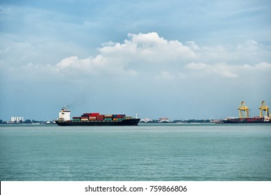 Big cargo ship with containers near the port in Penang, Malaysia