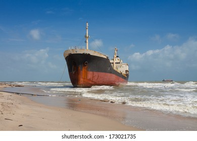big cargo ship run aground waiting for rescue
