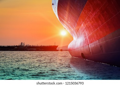 Big Cargo ship sailing in the sea with sunset go to Logistics and international shipping containers, cargo vessels ocean freight transportation.