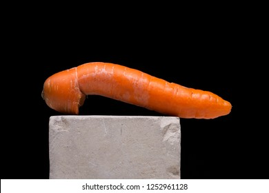 Big carrot looking like male penis, carrot as phallus
