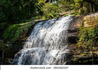 The big cascade of Ipiranguinha waterfall, one of the tourist attractions of Serra do Mar estate park in Cunha, Sao Paulo - Brazil.