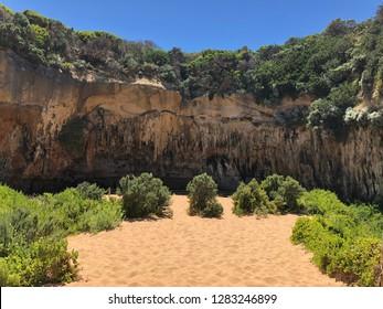 A big cave with cliff near a beach in Melbourne Australia