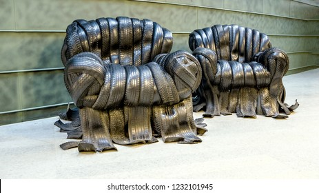 big Chairs made from used car tires. An example of a non-standard design from recycled materials. The background of the tread pattern of the car wheel. Rubber tires.