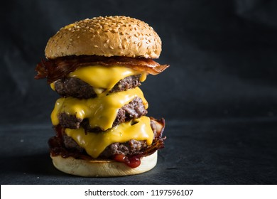 Big cheeseburger on a dark background