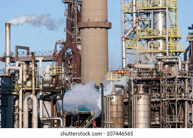 Big chemical factory with pipes and smokestacks