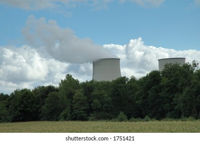 big chimney with white smoke, blue sky with whote clouds background