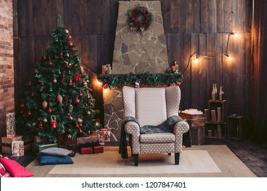 Big Christmas tree. Gifts under the tree. Christmas interior with stone fireplace