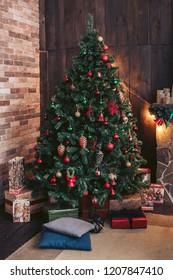 Big Christmas tree. Gifts under the tree. Cozy Christmas interior