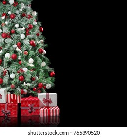 Big Christmas tree with red and white decorations with presents boxes under it isolated on black background