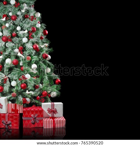 big christmas tree with red and white decorations with presents boxes under it isolated on black - Black Red White Christmas Decorations