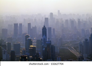 Big city in the fog - a view from the top