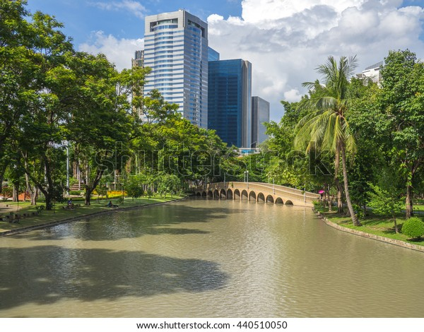 big city park with wetland Park and city building background