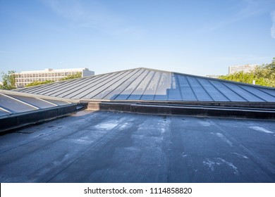 in a big city there is a flat roof on a high building
