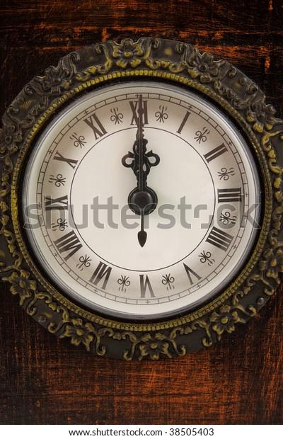 Big clock strikes twelve o'clock in closeup
