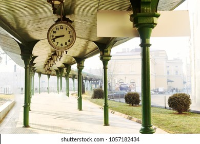 Big clock at the train station with sun rise background