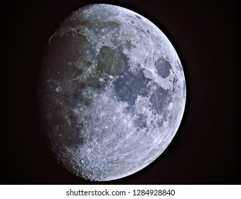 Big close up of Mineral Moon (waxing gibbous phase), taken with telescope, isolated in dark background with its natural colors.