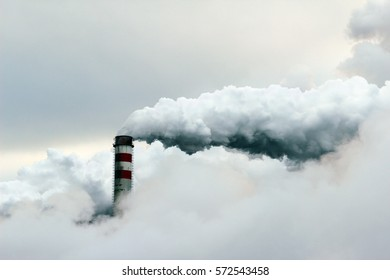 big cloud of smoke coming out of  power plant chimney, pollution air