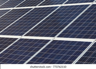 Big cluster of solar panels on a building roof