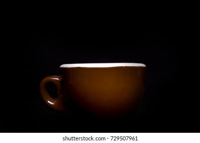 A big coffee cup on black background.