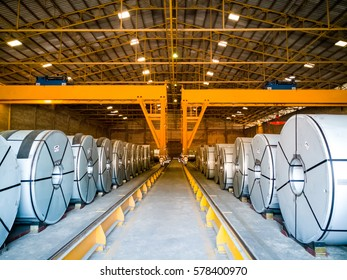Big coil store in warehouse and handling by overhead crane.