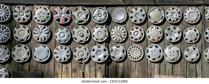 Big collection hubcaps on wall.  Lost hubcaps.