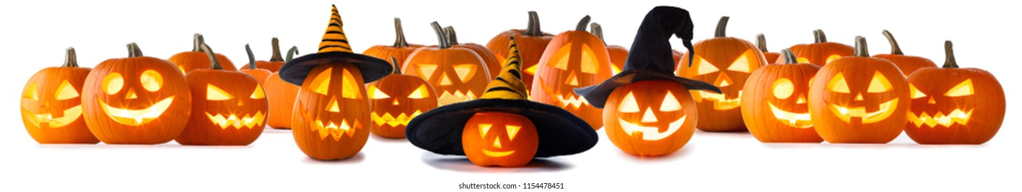 Big collection of Jack O Lantern Halloween pumpkins with various different designs and witches hat in a row isolated on white background