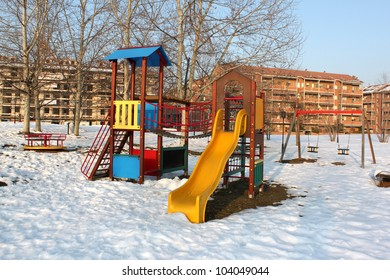 A big colorful children playground equipment  in snowy landscape
