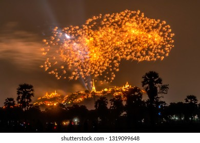 Big Colorful fireworks over the city (Annual Fair at Phra Nakhon Kiri, Phetchaburi, Thailand). Fireworks on the night sky with temples on the mountain.