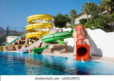 Big Colorful Waterslide in Aquapark with Pool