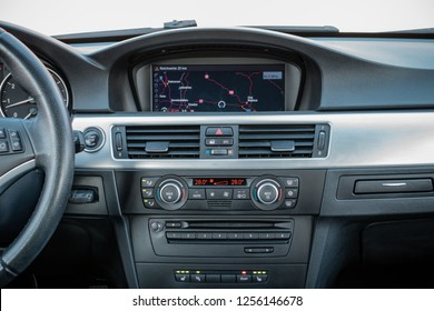 Big coloured navigation display unit showing Europe map. In dash original modern design - luxurious car. Air vents and air conditioning unit.