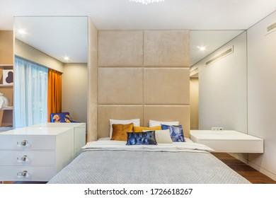 Big comfortable double bed in elegant  bedroom