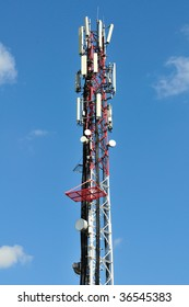 Big communication tower with GSM and microwave antenna.