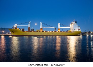Big containership with cranes in the evening in the Amsterdam Coenhaven harbour in the Netherlands.