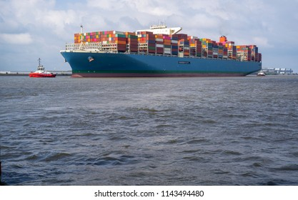 Big containership on the Elbe river near Hamburg, Germany
